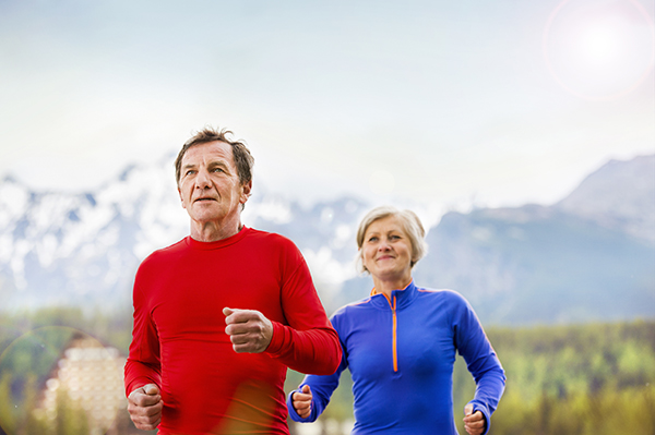 An older couple jogging